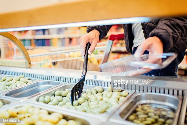 young man groceries shopping. - delicatessen stock photos and pictures