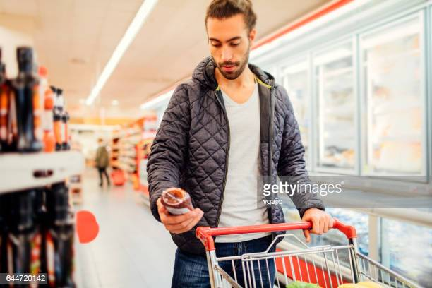 Young Man Groceries Shopping