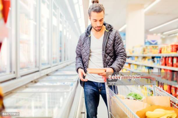 young man groceries shopping - man bun stock pictures, royalty-free photos & images