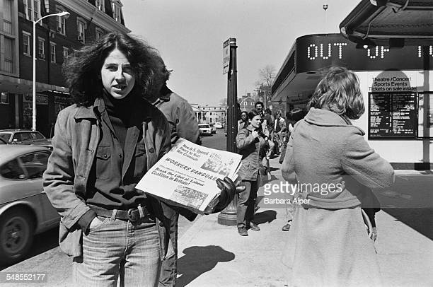 A young man handing out copies of the Workers Vanguard in Harvard Square Cambridge Massachusetts USA April 1977