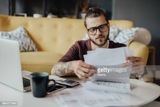 young man handled household expenses - bank account stock pictures, royalty-free photos & images