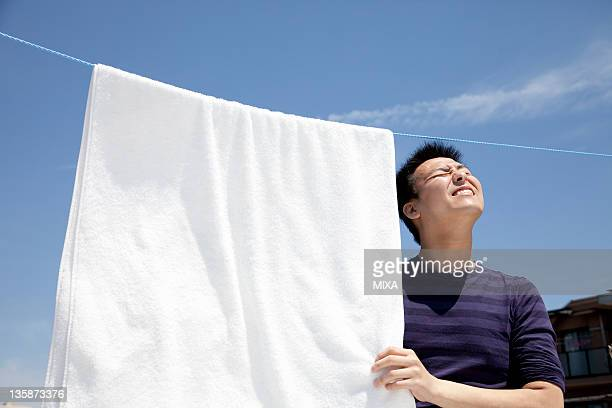 Young man hanging out laundry