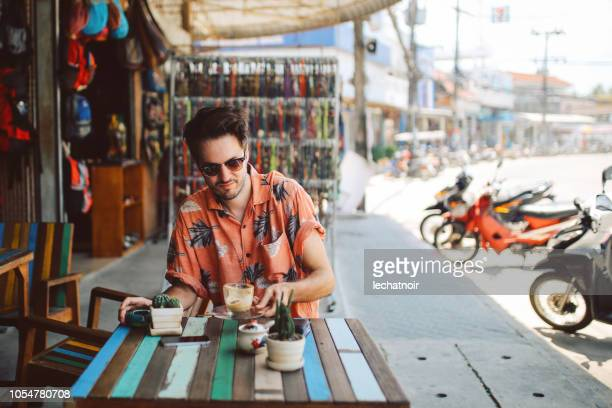 young man having a coffee in koh phangan, thailand - surat thani province stock pictures, royalty-free photos & images