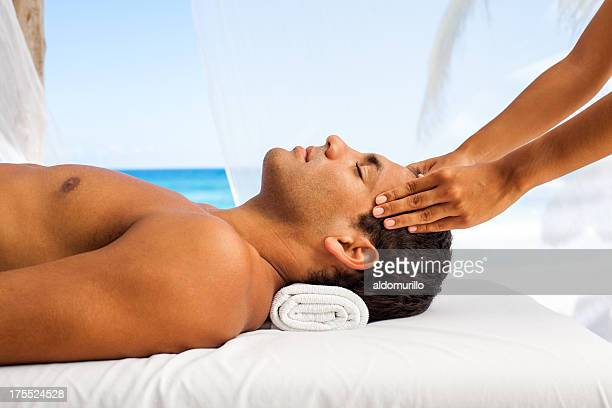 Young man having a massage on vacations
