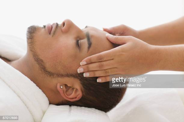 young man having a scalp massage - beautiful puerto rican women stock photos and pictures