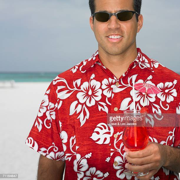 Young man having a tropical drink