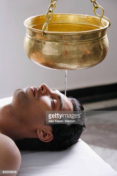 young man having Ayurvedic spa treatment