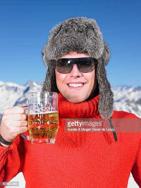 Young man having drink at mountains