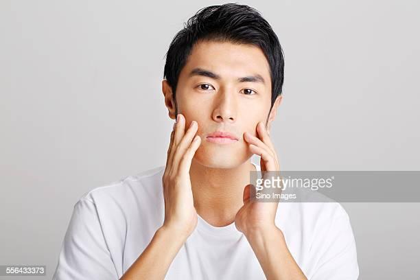 Young Man Having Facial Treatment