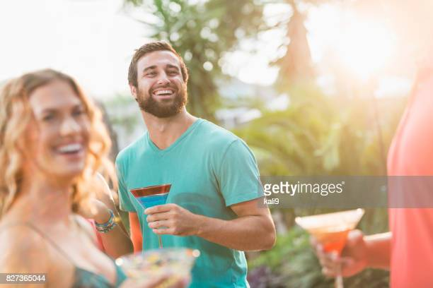 young man having fun at party - margarita drink stock photos and pictures