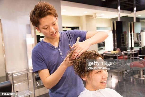 Young man having hair cut