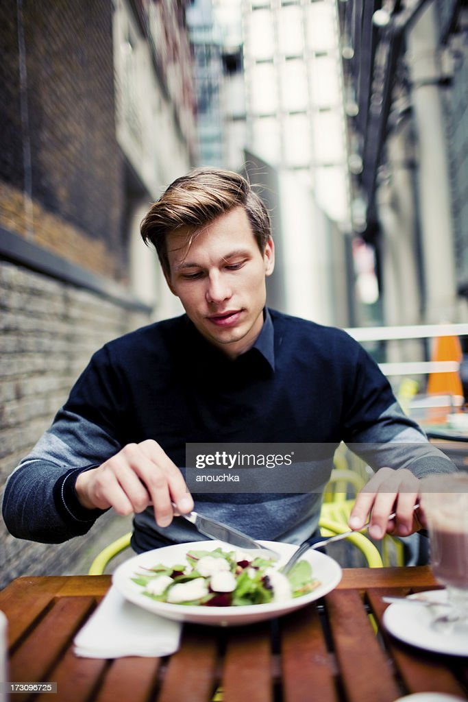 Young Man Having Healthy Lunch in Outdoor Cafe : Stock Photo