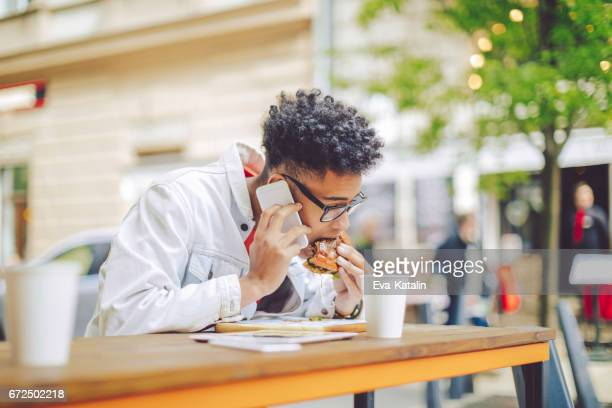 Young man having lunch in the city