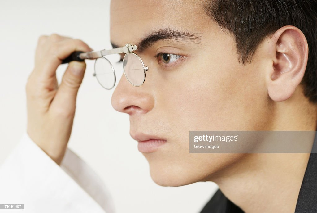 Young man having sight test : Stock Photo