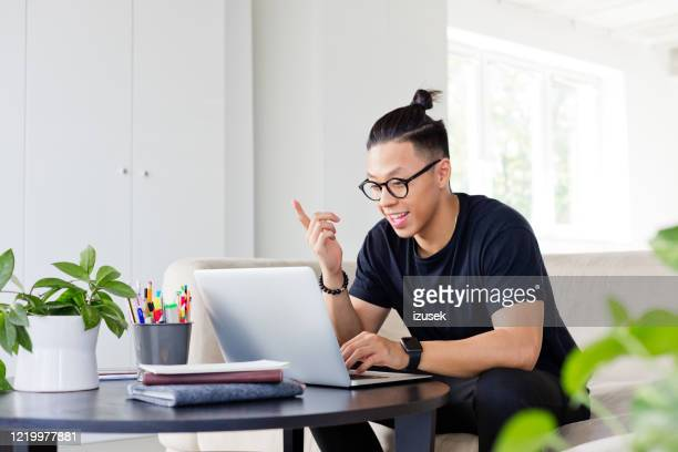 young man having video conference - environmental conservation stock pictures, royalty-free photos & images