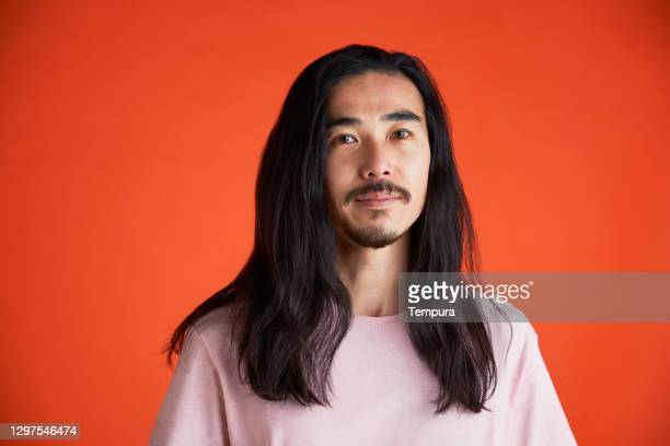 young man headshot portrait looking at the camera. - long hair stock pictures, royalty-free photos & images