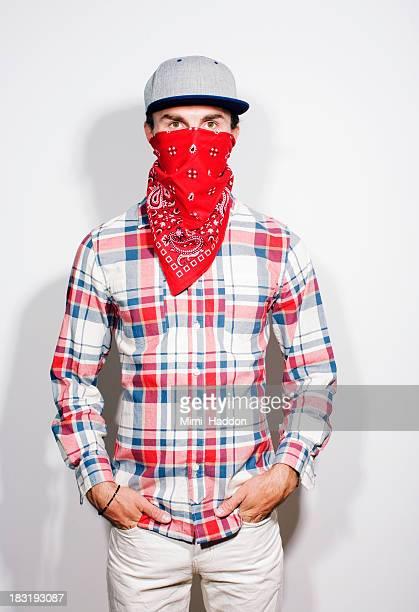 young man hiding face behind bandana - bandana stock pictures, royalty-free photos & images