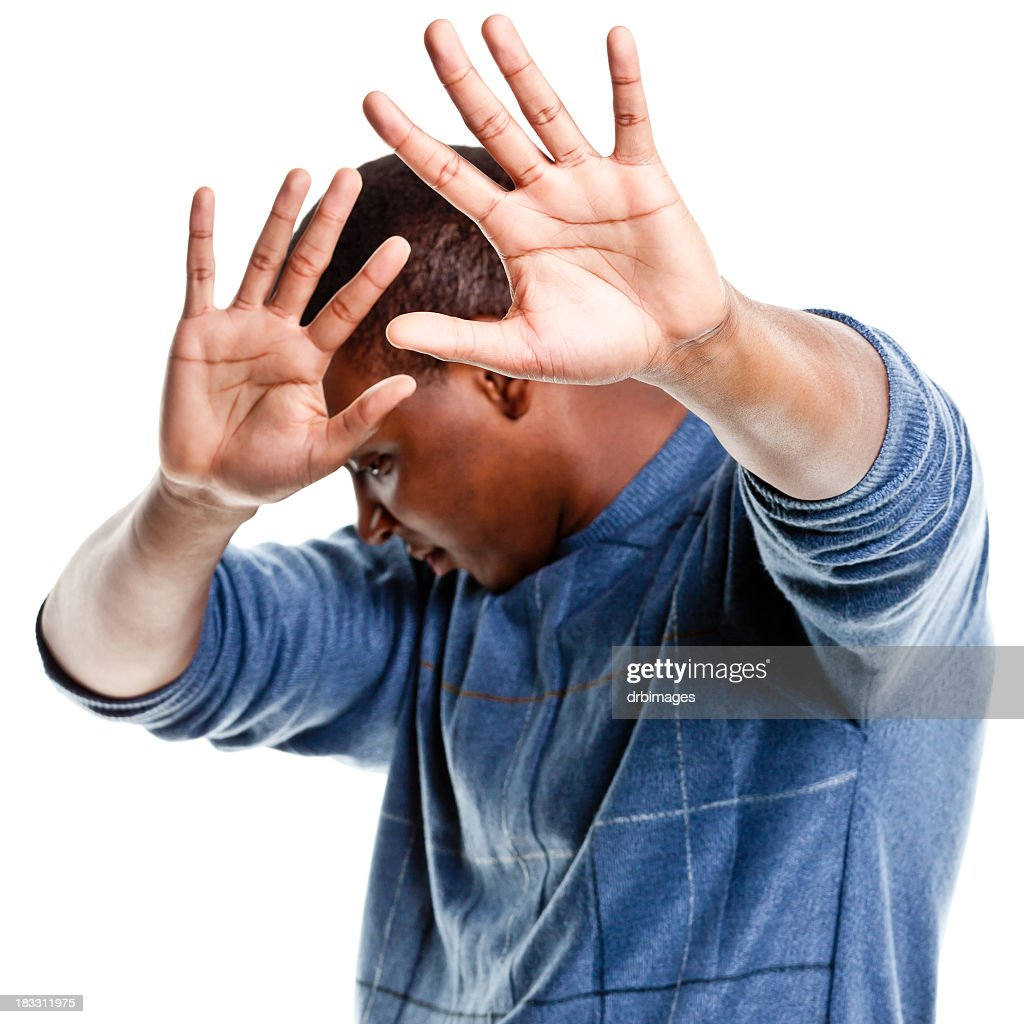 Young Man Hiding From the Camera : Stock Photo