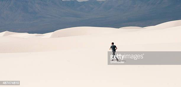 young man hiking across white sands - las cruces new mexico stock pictures, royalty-free photos & images