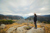 Young man hiking an filming with the action camera in Yosemite National Park, near by the Old Flat Oak Road
