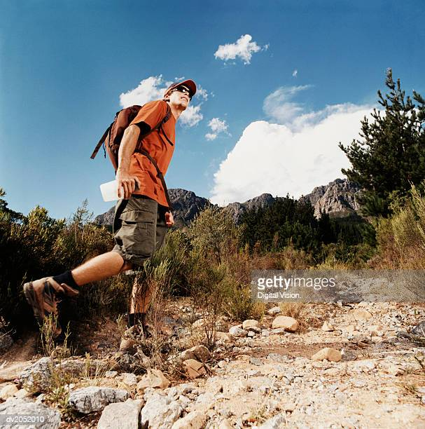 Young Man Hiking on a Mountain