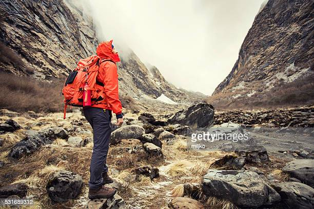 Young man hiking on mountains