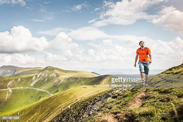 Young man hiking on path, Saint-Michel, Pyrenees, France (Near the Spanish-French border)