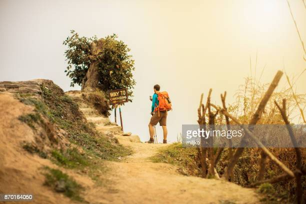 young man hiking - annapurna conservation area stock photos and pictures