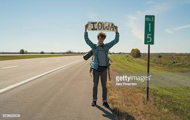 Young man, hitch-hiker, looking for a ride