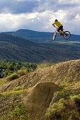 young man hits big dirt jump