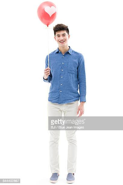 Young man holding a balloon