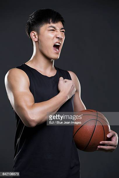 Young man holding a basketball