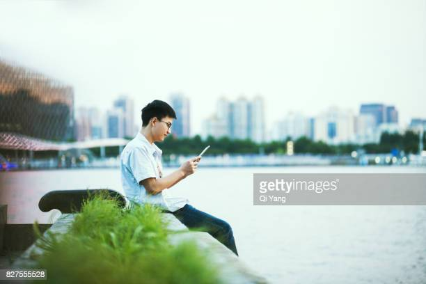 A young man holding a Digital Tablet,Shanghai,China