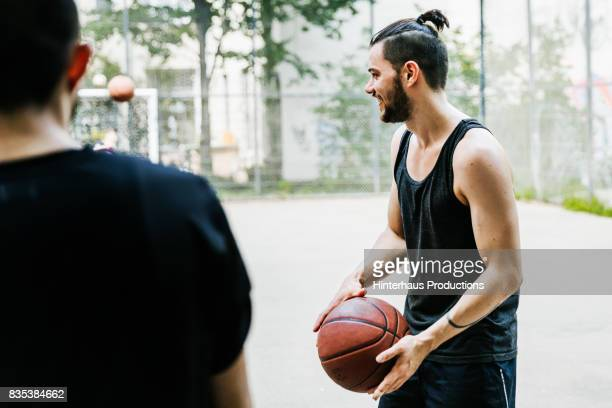 Young Man Holding Basketball Ready to Start The Game