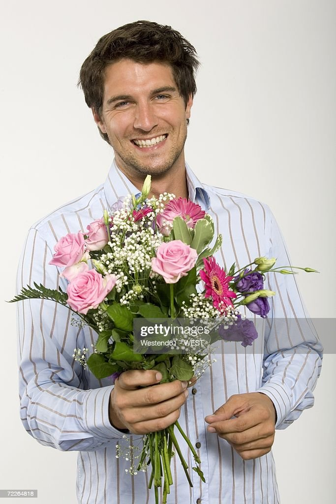 Young Man Holding Bouquet Of Flowers Smiling Closeup Portrait Stock ...