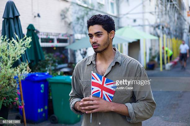 Young man holding British Flag