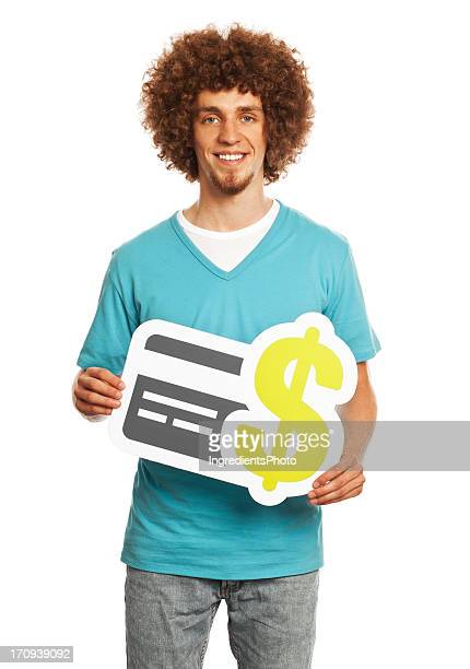 Young man holding credit card payment sign isolated on white.