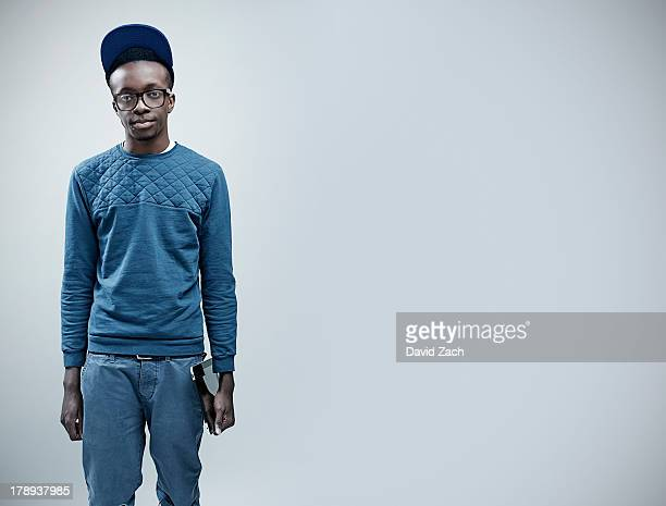 young man holding digital tablet - hipster culture stock pictures, royalty-free photos & images
