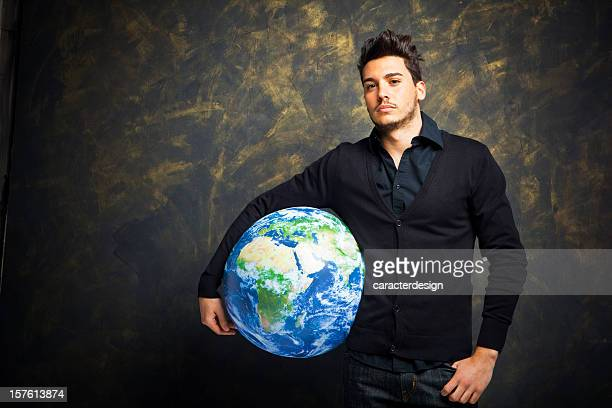 Young man holding Earth