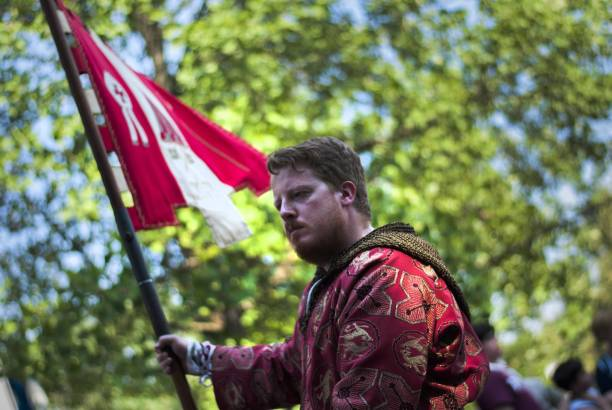 Young Man Holding Flag At Palio Di Legnano Against Trees