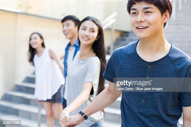 Young man holding hands with his girlfriend