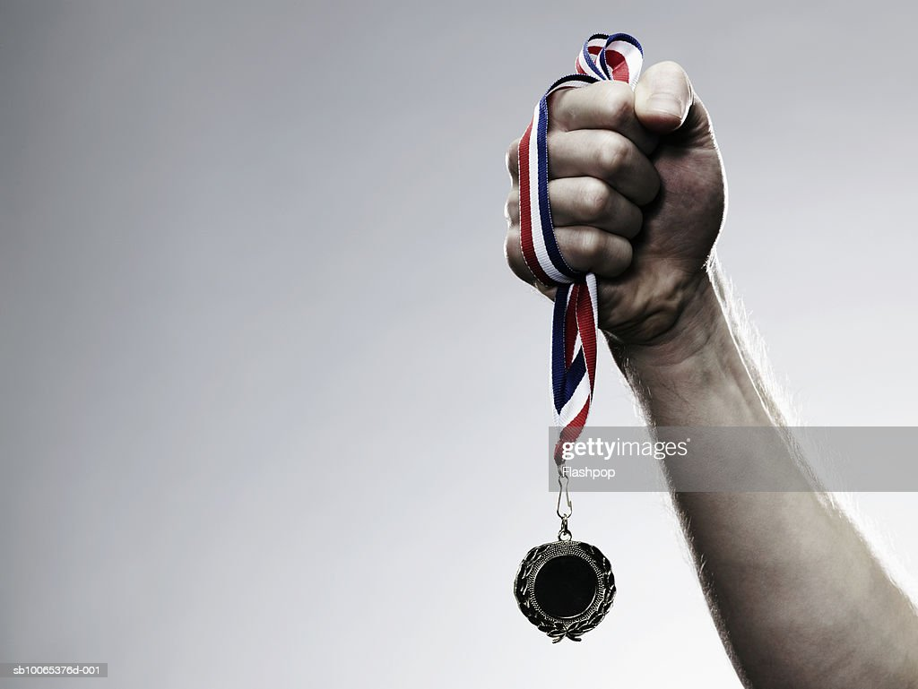 Young man holding medal, close-up : Foto stock