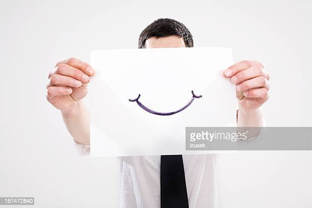Young Man Holding Out A Smile