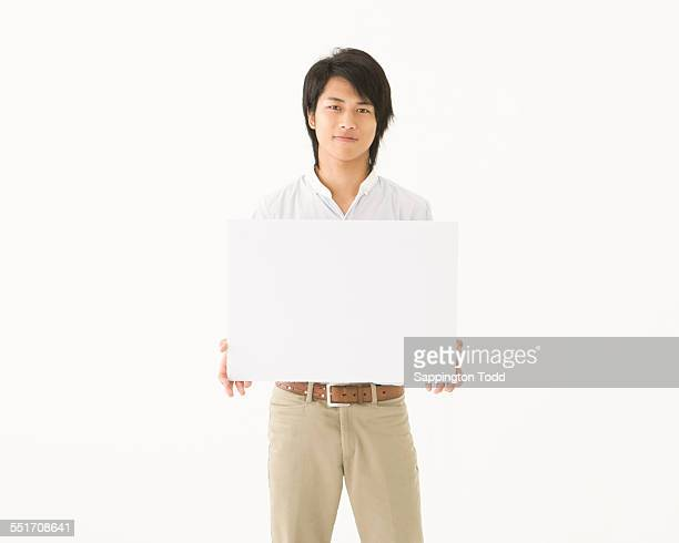 Young Man Holding Placard