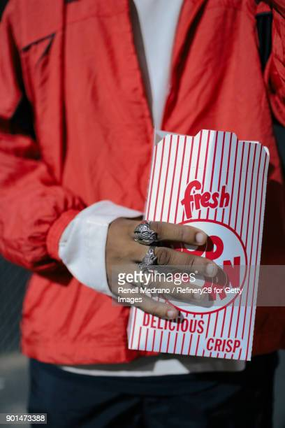 Young Man Holding Popcorn