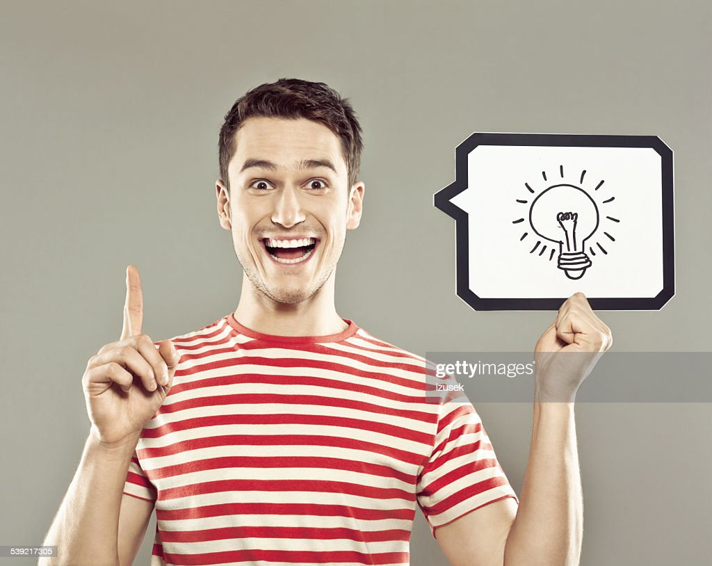 Young man holding speech bubble with light bulb : Stock Photo