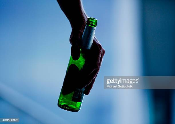 A young man holds a beer bottle on August 13 2014 in Berlin Germany