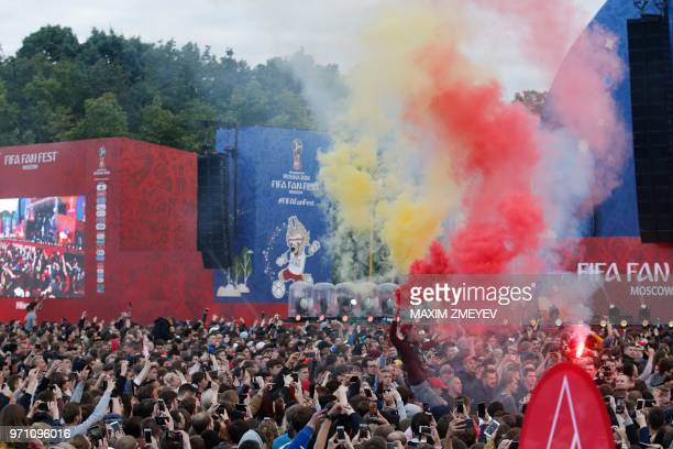 A young man holds smoke flares during the official opening ceremony of the FIFA Fan Fest in Moscow on June 10 ahead of the Russia 2018 World Cup
