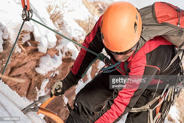 Young Man Ice Climbing