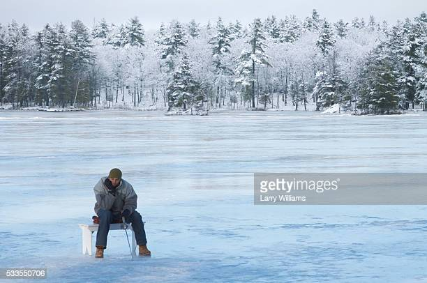 Young man ice fishing